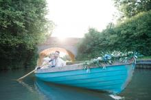 rowboat on photo shoot for wedding magazin